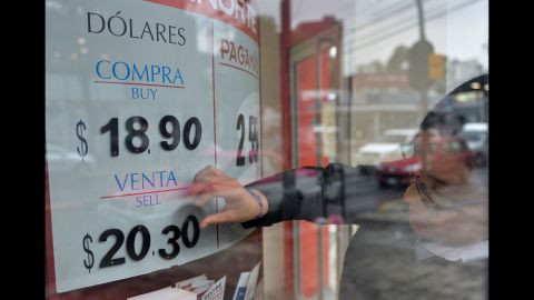"""The U.S. dollar exchange rate is seen on the board of a bank in Mexico City on November 9. The dollar tumbled against the yen and euro while the Mexican peso <a href=""""http://money.cnn.com/2016/11/09/investing/mexican-peso-trump-us-election/"""" target=""""_blank"""">fell off a cliff</a> as polling results pointed to a strong showing by Trump."""