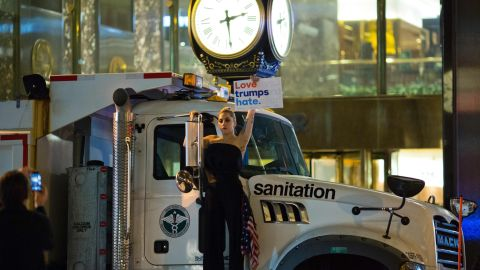 Lady Gaga protests against Donald Trump early Wednesday outside Trump Tower in New York.