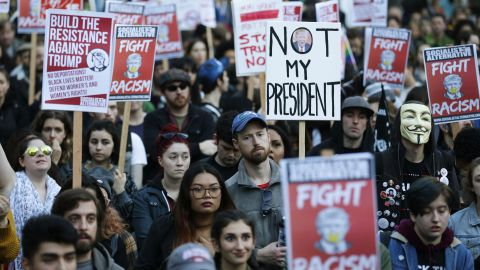 People listen to speakers protesting Trump's election in Seattle on November 9.