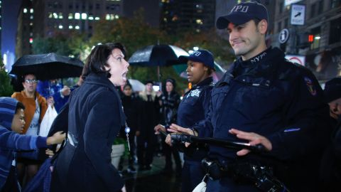 """A woman argues with police officers during a protest in New York on November 9. Erin Michelle Threlfall, the woman pictured, told <a href=""""http://www.huffingtonpost.com/entry/5824aa40e4b0270d9a2ad89e?timestamp=1478799395467"""" target=""""_blank"""" target=""""_blank"""">The Huffington Post </a>she was attempting to intervene on behalf of a man she says the police were beating."""