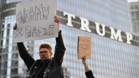 Protesters in Chicago display anti-Trump signs near the Trump International Hotel and Tower on November 9.