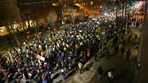 Demonstrators march down Second Avenue in Seattle on November 9.