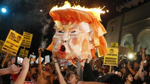 Protesters set an effigy of Trump on fire outside Los Angeles City Hall on Wednesday, November 9.