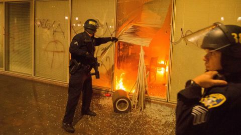 Police respond to a fire set by anti-Trump protesters in Oakland, California, on November 9. Police said some protesters threw Molotov cocktails, rocks and fireworks at officers.