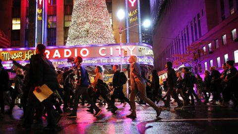Demonstrators march past Radio City Music Hall in New York on November 9.