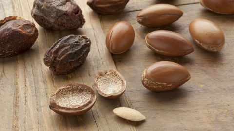 To extract the oil-rich kernels, workers first dry argan fruit, remove the fleshy pulp then crack open the hard outer case.