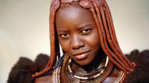 """Women of the semi-nomadic <a href=""""http://edition.cnn.com/2012/05/11/world/africa/himba-namibia-inside-africa/"""">Himba tribe</a> in northern Namibia are famous for their reddish hair and complexion. It's the result of <em>otjize</em>, a paste of butter, fat and red ocher, applied daily to their hair and skin. It was once speculated that the <em>otjize</em> served as a form of sun protection and to ward off insects, however the women say it's purely for aesthetic reasons -- which makes sense, given that Himba men don't take part in the practice."""