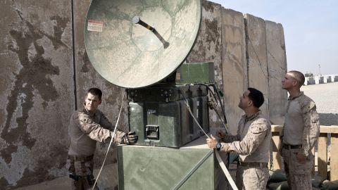 US Marines install equipment at a coalition base in Qayyara on November 9.
