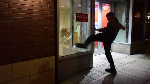 """A protester kicks the window of a Bank of America branch in Portland, Oregon, on November 10. What started out as a peaceful march with more than 4,000 people <a href=""""http://www.cnn.com/2016/11/11/us/oregon-protest-riot/index.html"""" target=""""_blank"""">quickly turned violent.</a> Portland police publicly declared a """"riot"""" because of """"extensive criminal and dangerous behavior,"""" according to posts on the department's Twitter page."""