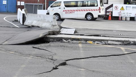 Fissures run along a road by the Centre Port in Wellington, Monday, November 14 after a 7.8 magnitude earthquake struck New Zealand's south Island early in the morning.