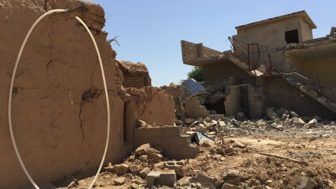In this handout image provided by Human Rights Watch, destroyed houses are seen in Qarah Tappah, Iraq, with partial red X still visible, May 20, 2016. Human Rights Watch is accusing the security forces of Iraq's regional Kurdish government of destroying Arab homes and even some villages in areas retaken from the Islamic State group. The report says that between September 2014 and May 2016, forces advancing against IS destroyed Arab homes in disputed areas of Kirkuk and Nineveh governorates, while Kurdish homes were left intact. (Human Rights Watch via AP)