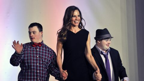 """Oscar winner Hilary Swank walks the runway with two models during the 2016 Global Down Syndrome Foundation """"Be Beautiful, Be Yourself"""" fashion show."""