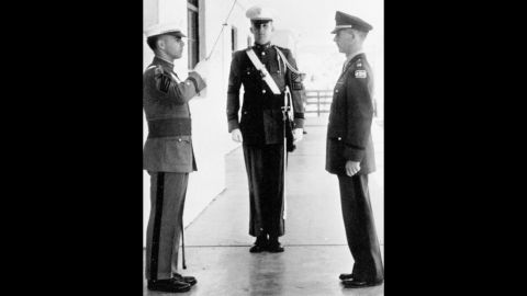 Trump, center, stands at attention during his senior year at the New York Military Academy in 1964.