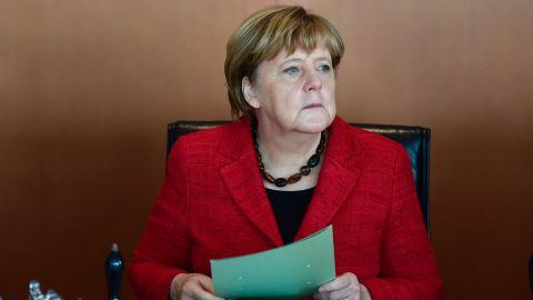 German Chancellor Angela Merkel handles folders at the start of  the weekly cabinet meeting in Berlin on November 9, 2016. handles folders at the start  / AFP / TOBIAS SCHWARZ        (Photo credit should read TOBIAS SCHWARZ/AFP/Getty Images)