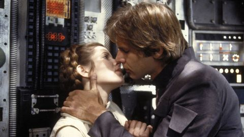 """Carrie Fisher and Harrison Ford kiss in a scene from """"The Empire Strikes Back."""""""
