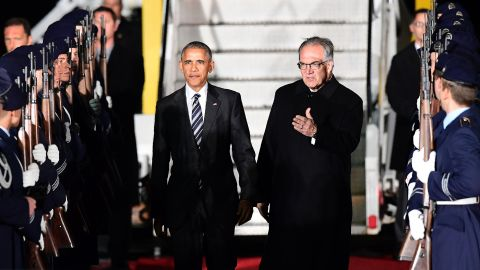 Obama is greeted by a guard of honor after flying into Berlin on Wednesday, November 16.