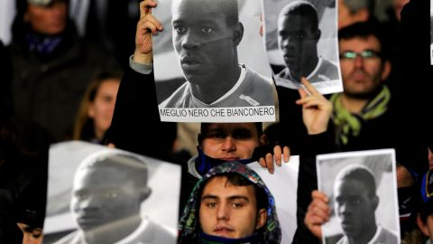 """In 2009 Inter Milan fans held up posters supporting Mario Balotelli in response to racist abuse that the player received at Juventus. The English translation of the posters is """"Better black than Juventus."""""""