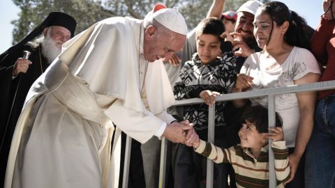 MYTILENE, GREECE - APRIL 16:  In this handout image provided by Greek Prime Minister's Office, Pope Francis meets migrants at the Moria detention centre on April 16, 2016 in Mytilene, Lesbos, Greece. Pope Francis will visit migrants at the Moria camp on the Greek island of Lesbos along with Greek Orthodox Ecumenical Patriarch Bartholomew I and Archbishop of Athens and All Greece, Ieronimos II.