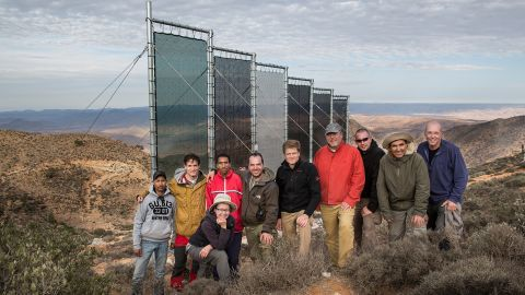 """This Moroccan NGO, <a href=""""http://darsihmad.org/fog/"""" target=""""_blank"""" target=""""_blank"""">Dar Si Hmad</a>, runs the largest functioning fog collection project, generating an average of 6,000 liters of water a day. Pictured here, members of the team in Morocco pose with German colleagues."""