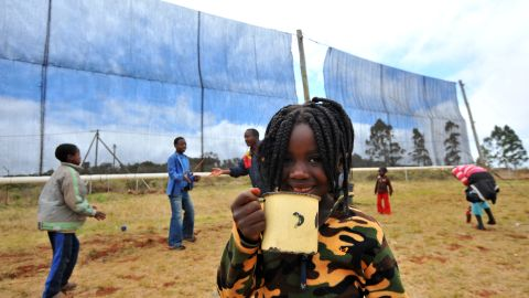 Pictured here, a child drinks a glass of water caught by the fog nets at Tshiavha primary school in Limpopo, in 2011.