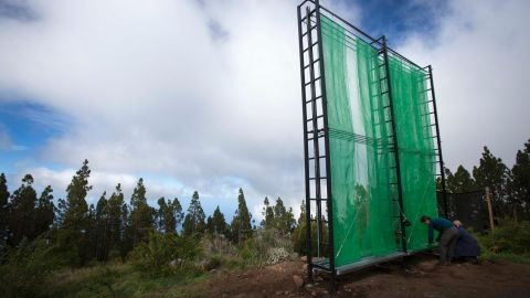 Pictured here, engineers install a new type of fog collector on Tenerife in November 2015 in order to compare the result with the Chilean-type collectors installed alongside.<br />