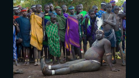 """Every June or July in the Omo Valley, Ethiopia, the <em>Ka'el</em> -- the Bodi lunar new year -- takes place. With it comes an extraordinary show of pageantry. In the months before the event men live in isolation and drink to excess <a href=""""https://www.cnn.com/2015/10/02/africa/milk-big-business-africa/index.html"""" target=""""_blank"""">a mixture of cow milk and cow blood</a> for months in order to become vastly bloated and overweight. Each clan will then present an unmarried male to compete for the title of fattest man -- and with the glory, the greater chance of finding a wife. With stomachs swollen, balance and fatigue can be an issue, but once the event is over, contestants return to their normal size in a matter of weeks."""