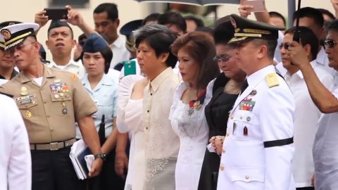 """Marcos family members, including his children, Ferdinand """"Bongbong"""" Marcos and Imee Marcos, and his widow Imelda Marcos (in black) attend the ceremony."""