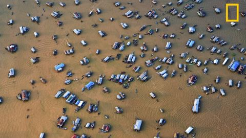 """Photo: Stuart Chape, Samoa: """"This aerial view of the Chong Kneas floating village on Tonle Sap lake, Cambodia, demonstrates just how threatened the great lake is from changing rainfall patterns and rising temperatures.""""<em> </em><em>Via National Geographic Your Shot</em>"""