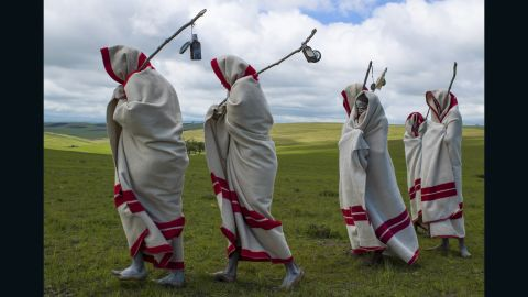 """In Eastern Cape, South Africa, young Xhosa men take part in a coming of age initiation called<em> Ulwaluko</em>. The youths, known as <em>abakhwetha</em>, are first circumcised without anesthetic, and must live in the bush with minimal supplies. Wearing white clay on their faces, initiates will fend for themselves for up to two months, living in a structure built by the village's adult community specifically for<em> Ulwaluko</em>. Upon their return they are no longer referred to as """"boy"""" and receive a new blanket. The initiation has not been without its criticisms, due to <a href=""""http://www.bbc.co.uk/news/world-africa-19256839"""" target=""""_blank"""" target=""""_blank"""">complications and malpractice</a> surrounding the circumcision process."""