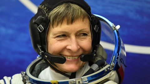 Member of the main crew of the 50/51 expedition to the International Space Station (ISS), US astronaut Peggy Whitson looks on in her space suit at the Russian-leased Baikonur cosmodrome in Baikonur, prior to blasting off to the International Space Station (ISS) late on November 17. The International crew of France's astronaut Thomas Pesquet, Russia's cosmonaut Oleg Novitsky and US astronaut Peggy Whitson are scheduled to blast off to the International Space Station (ISS) from the Baikonur cosmodrome early on November 18 local time. / AFP / Kirill KUDRYAVTSEV        (Photo credit should read KIRILL KUDRYAVTSEV/AFP/Getty Images)