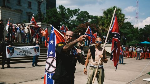 A member of th Ku Klux Klan from Kentucky, left, and a member of the Loyal White Knights a branch of the Ku Klux Klan from Pelham, North Carolina are seen during a Klan rally at the South Carolina State House in protest against the removal of the Confederate Flag from the State House grounds on July, 18, 2015.