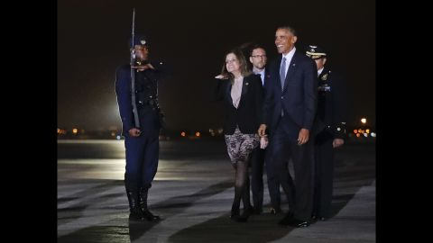 Mercedes Araoz, Peru's second vice president, joins Obama on the tarmac after his arrival at an airport near Lima on Friday, November 18.
