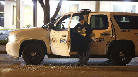 """Police investigate a scene after a St. Louis police officer was shot in what the police chief called an """"ambush"""" on Sunday, Nov. 20, 2016, in St. Louis. Police Chief Sam Dotson said the 46-year-old officer was shot in the face. The suspect got away and a massive search was underway. (David Carson/St. Louis Post-Dispatch via AP)"""