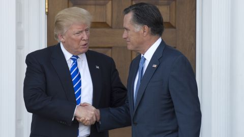 US President-elect Donald Trump shakes hands with Mitt Romney after their meeting at the clubhouse of Trump National Golf Club on November 19, 2016 in Bedminster, New Jersey. / AFP / Don EMMERT        (Photo credit should read DON EMMERT/AFP/Getty Images)
