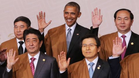 """US President Barack Obama, center, poses for a group photograph Sunday, November 20, at the summit of the Asia-Pacific Economic Cooperation. The summit was held in Lima, Peru. Joining Obama in this photo, from left, are Thai Deputy Prime Minister Prajin Juntong, Japanese Prime Minister Shinzo Abe, South Korean Prime Minister Hwang Kyo-ahn and Vietnamese President Tran Dai Quang. Obama is on <a href=""""http://www.cnn.com/2016/11/14/politics/obama-trip-greece-germany-peru/index.html"""" target=""""_blank"""">his last international trip as president.</a> He made earlier stops in Greece and Germany."""
