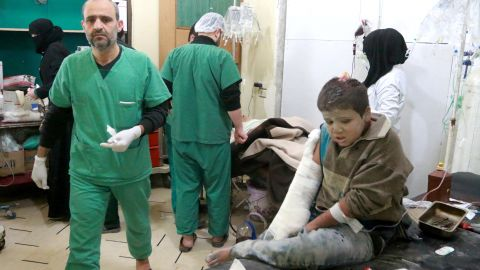 A wounded Syrian boy receives treatment at a hospital in eastern Aleppo.