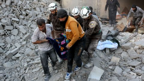 Syrian civil defence volunteers, known as the White Helmets, evacuate a victim from the rubble of a building following reported airstrikes on Aleppo's rebel-held district of al-Hamra on November 20, 2016. / AFP / THAER MOHAMMED        (Photo credit should read THAER MOHAMMED/AFP/Getty Images)