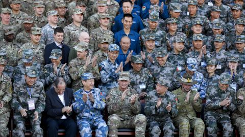 U.S. Army Pacific commander Gen. Robert Brown, front row center, and Gen. Liu Xiaowu, front row third right, the commander for Southern Theater Command Army of Chinese Liberation Army (PLA), applaud with their soldiers at a group photo session after conducting the U.S.-China Disaster Management Exchange (DME) drill at a PLA's training base in Kunming in southwest China's Yunnan province, Friday, Nov. 18, 2016. Chinese and U.S. troops staged joint drills Friday in an effort to better coordinate a response to humanitarian disasters and build confidence between their militaries that remain deeply wary of each other. (AP Photo/Andy Wong)
