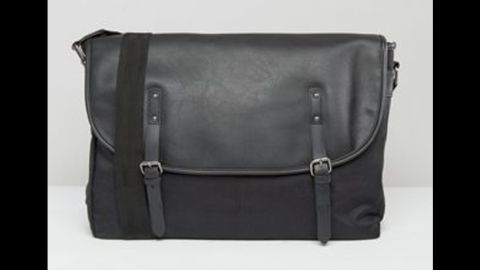 """For Chrissy Teigen, a man bag is exactly what John Legend wants for the holidays. <a href=""""http://www.asos.com/asos/asos-satchel-in-black-faux-leather/prd/6506023?iid=6506023&clr=Black&cid=9265&pgesize=36&pge=0&totalstyles=721&gridsize=3&gridrow=3&gridcolumn=1"""" target=""""_blank"""" target=""""_blank"""">Check out this ASOS satchel here.</a>"""