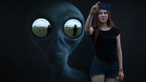 A woman takes a selfie at Alfa Future People, an electronic music festival in Nizhny Novgorod, Russia, on Friday, July 22.