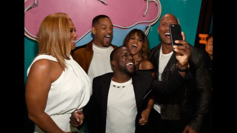 Comedian Kevin Hart takes a selfie with, from left, actors Queen Latifah, Will Smith, Halle Berry and Dwayne Johnson on Saturday, April 9. Hart and Johnson were hosting the MTV Movie Awards.