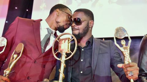 Ivory Coast's coupe-decale musician DJ Arafat (R) and DJ Serge Beynaud present their awards during the Coupe-Decale Awards on October 15, 2016 in Abidjan.