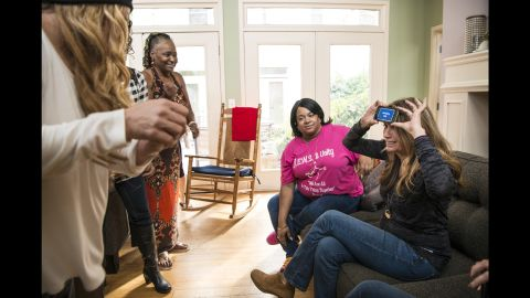Stevens plays a game with staff and residents of Magdalene, one of Thistle Farms' residential facilities.