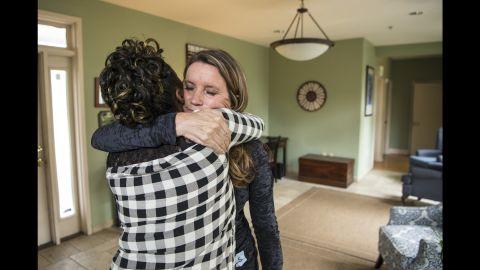 Stevens shares a hug with a resident of Magdalene.