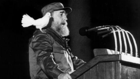 This file photo taken on January 8, 1989 shows a white dove landing on Cuban president Fidel Castro's shoulder as he delivers a speech to Cuban youth at a ceremony to commemorate the 30th Anniversary of the Cuban Revolution in Havana. Cuban revolutionary icon Fidel Castro died late on November 25, 2016 in Havana,