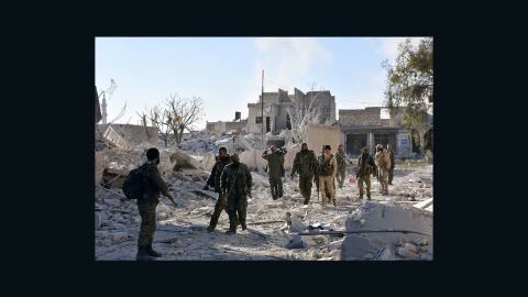 Syrian pro-government forces in the Masaken Hanano district in eastern Aleppo on Sunday as regime forces seized it from rebels, in this photo from the Rumaf Syrian-Kurdish activist group.