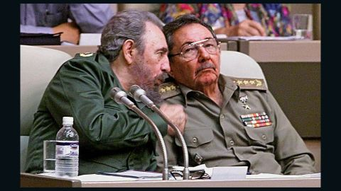 """HAVANA, CUBA:  (FILE) Picture taken 20 December 1999, in Havana of Cuban President Fidel Castro (L) speaking with his brother ad Armed Forces Minister Raul Castro during the IV Working Session of the National Assembly. A spokesman of Cuban President Fidel Castro read on Cuban National TV a document signed by him, 31 July 2006, by which he delegates power to his brother Raul Castro. Fidel Castro underwent surgery shortly after coming back from Mercosur?s Summit in Cordoba, Argentina. """"I do delegate, provisionally, my duties as first secretary of the Central Committee of the Communist Party in Cuba, to the second secretary, comrade Raul Castro Ruz,"""" Castro said. (ELECTRONIC IMAGE)   AFP PHOTO/ADALBERTO ROQUE  (Photo credit should read ADALBERTO ROQUE/AFP/Getty Images)"""