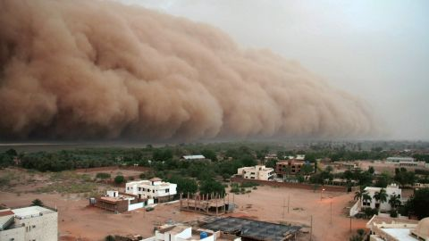 """A gigantic cloud of dust known as """"Haboob"""" advances over Sudan's capital, Khartoum. Moving like a thick wall, it carries sand and dust burying homes, while increasing evaporation in a region that's struggling to preserve water supplies. <a href=""""http://edition.cnn.com/2016/12/07/africa/sudan-climate-change/index.html"""">Experts say</a> that without quick intervention, parts of the African country -- one of the most vulnerable in the world -- could become uninhabitable as a result of climate change."""