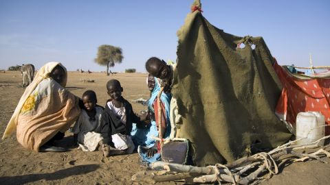 People displaced from Darfur's conflict arrive at Shangel Tubaya in 2010.