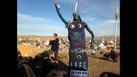 A sculpture stands at an encampment where protesters of the pipeline have been gathered for months.